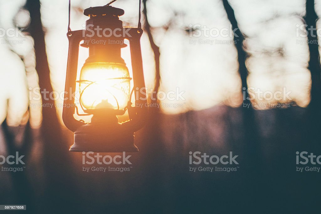 Sun captured in old lantern stock photo
