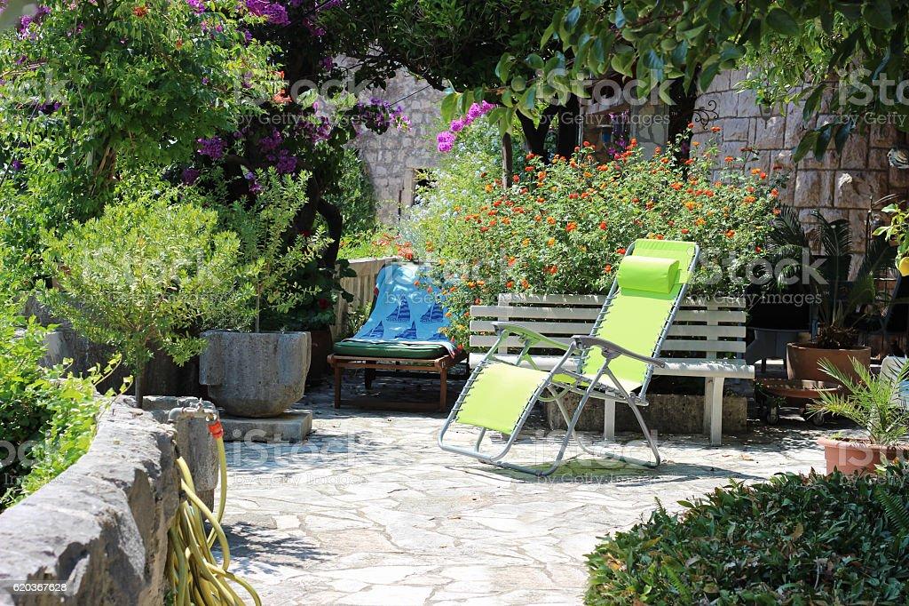 sun chairs in the beach garden zbiór zdjęć royalty-free