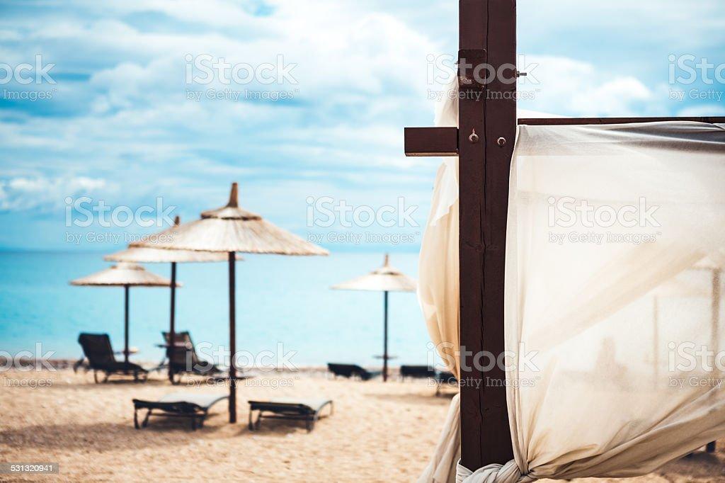 Sun Chairs On Sandy Beach stock photo