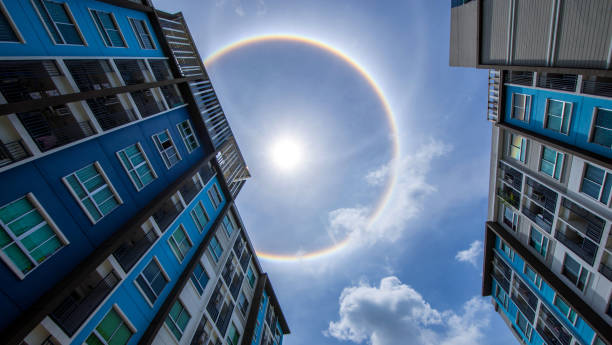 sun corona rainbow clouds and blue sky background , Circumscribed halo stock photo