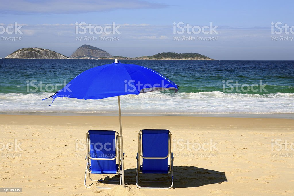 sun deck chair under parasol  ipanema beach  rio de janeiro royalty-free stock photo