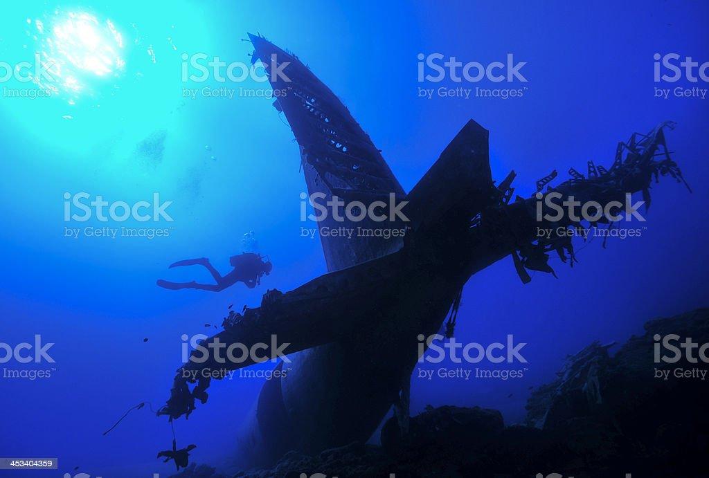 Sun diver an plane wreck stock photo