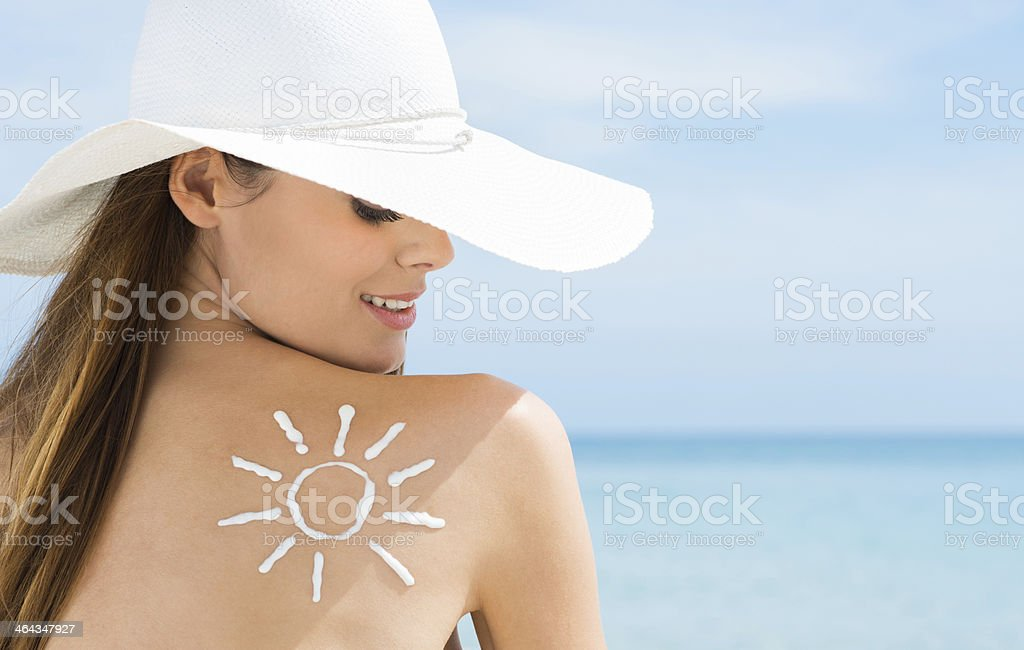 Sun Drawn On Woman's Shoulder Suntan Lotion stock photo