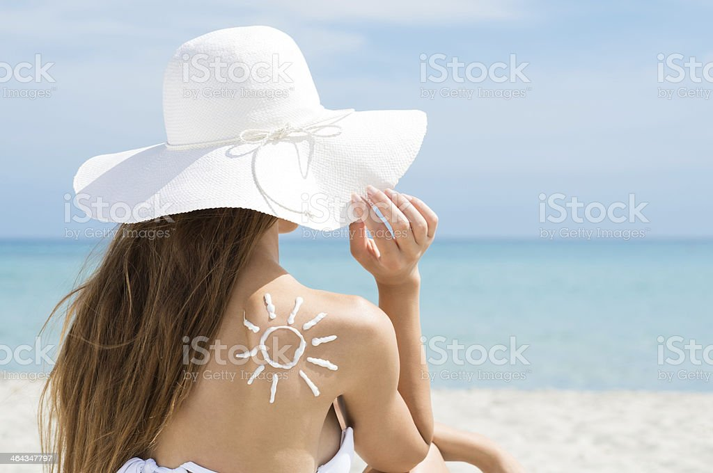 Sun Drawn With Suntan Lotion Woman's Shoulder stock photo