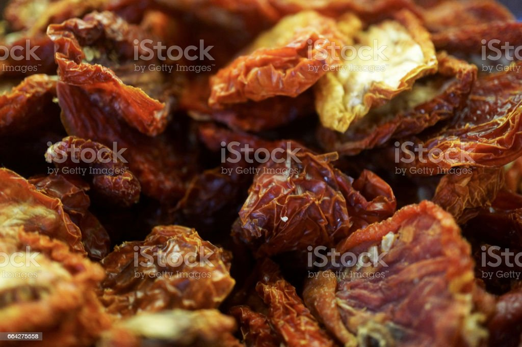 sun dried tomatoes background stock photo