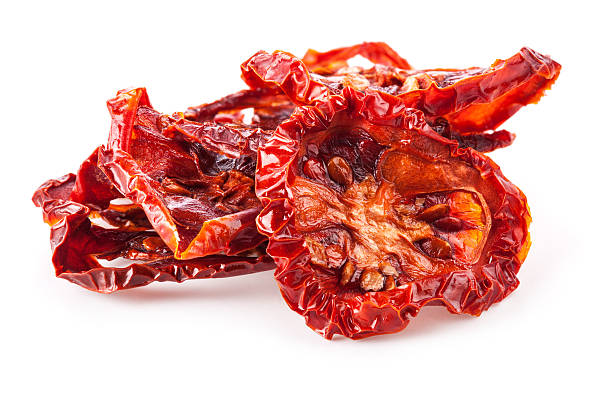 Sun dried tomatoes Sun dried tomatoes isolated on white background dried plant stock pictures, royalty-free photos & images
