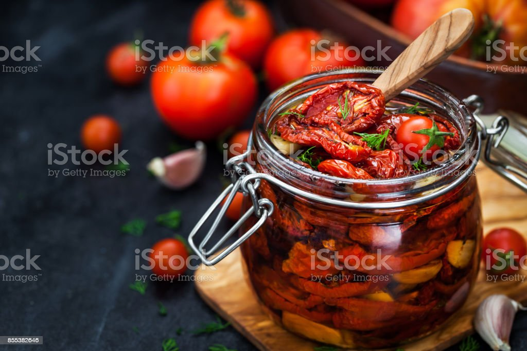 Sun dried tomatoes with garlic and olive oil stock photo