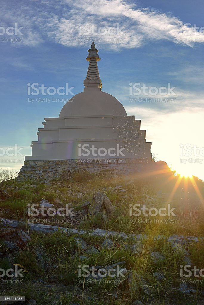 Sun dust near buddhist stupa royalty-free stock photo