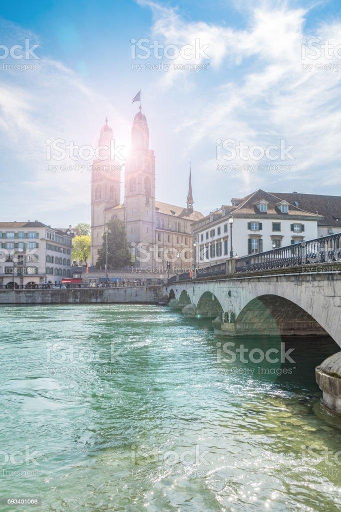 Sun flare through spires at Grossmunster church in Zurich stock photo