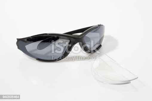 Sun glasses and lens in a white background composition