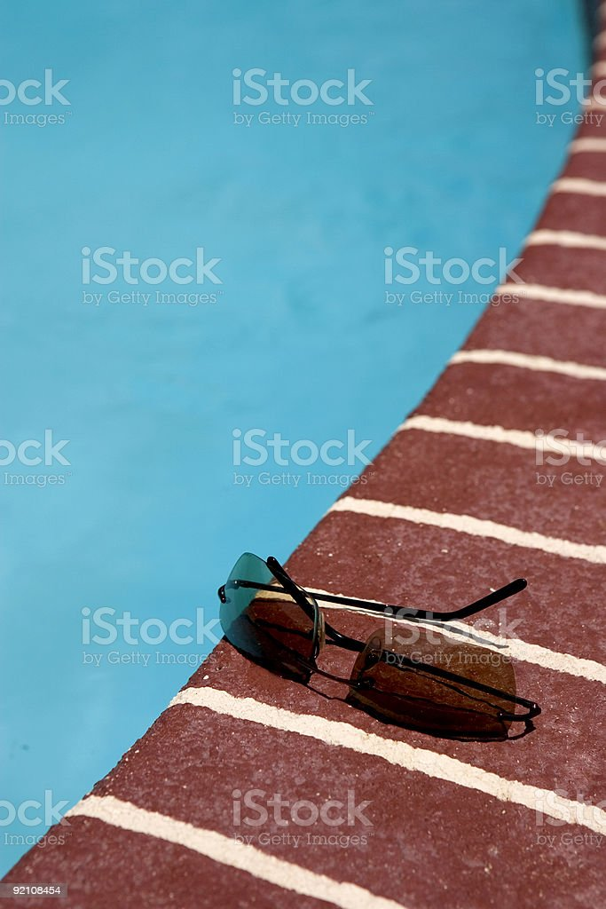 Sun glasses by the pool stock photo