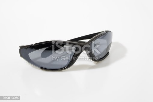 Sun glasses in a white background composition