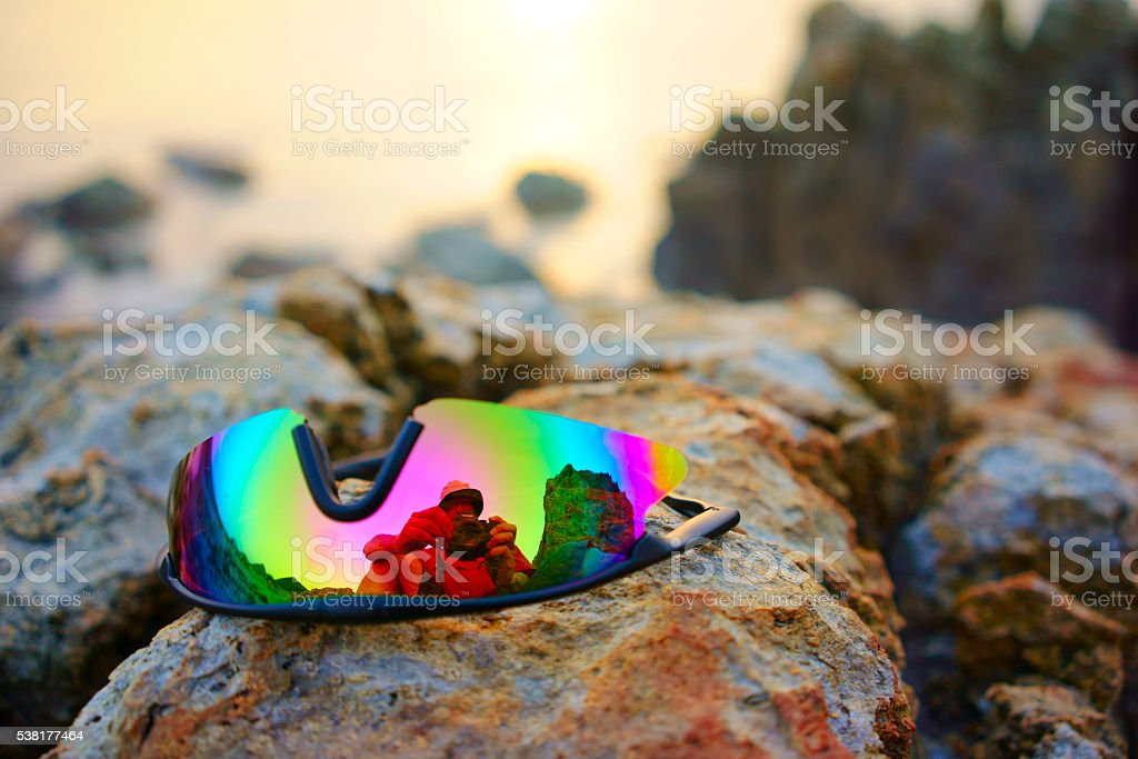sun glasses on reef at beach. stock photo
