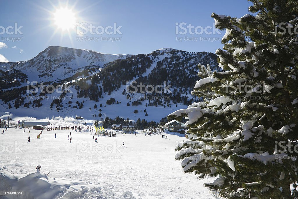 Sun goes down on ski slopes in Andorra royalty-free stock photo