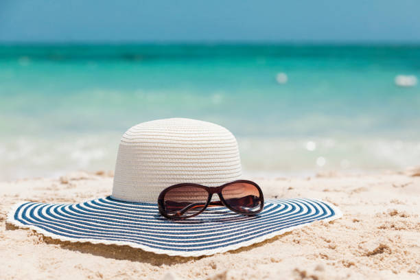 Sun Hat and Sunglasses on the Beach in The Bahamas stock photo