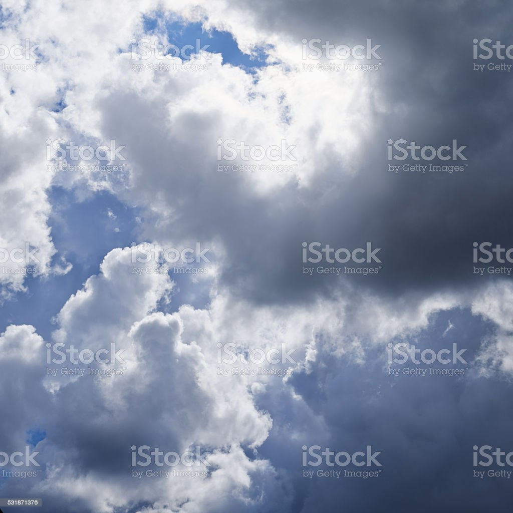 Sun hidden behind the clouds stock photo