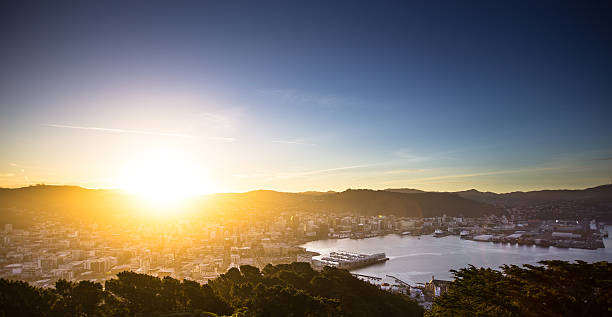 Sun Hitting the Horizon Over Wellington Still from Getty time lapse video #625850288. View of Wellington from Mount Victoria at sunset. mt victoria canadian rockies stock pictures, royalty-free photos & images