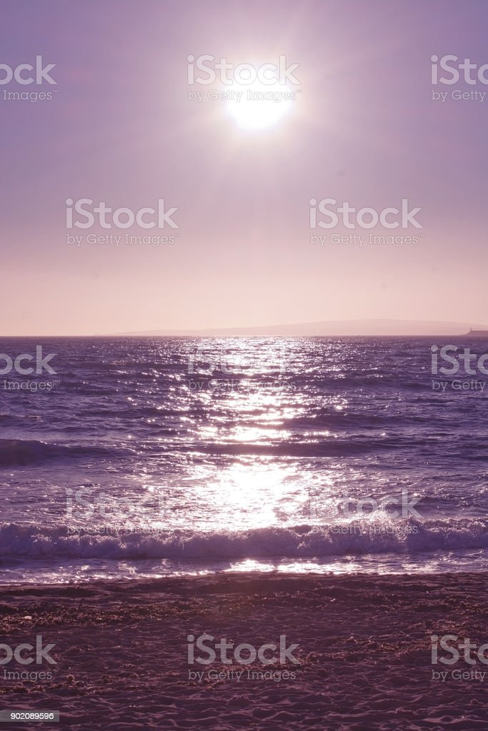 Sun horizon and ocean tinted in ultraviolet stock photo