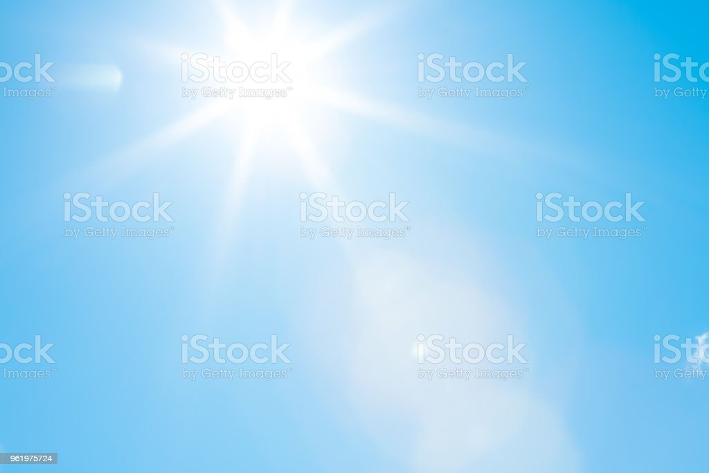 Sun in a blue sky - 50 megapixels Bright sun with beautiful beams in a blue sky. Space for copy. High resolution - 50 megapixels. Blue Stock Photo