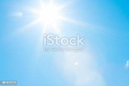 istock Sun in a blue sky - 50 megapixels 961975724
