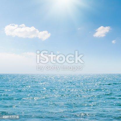 istock sun in blue sky over sea 498117216