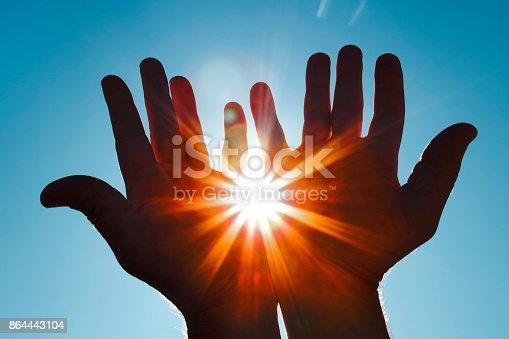 istock Sun in my hands 864443104