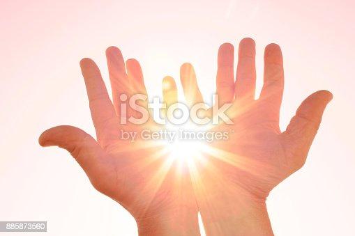 istock Sun in my hands 885873560
