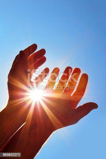istock Sun in my hands 955832072