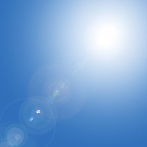 Sun in the blue sky stock photo