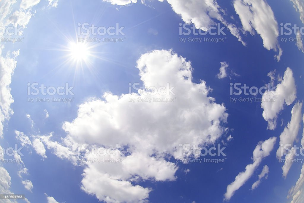 Sun in the sky with clouds stock photo