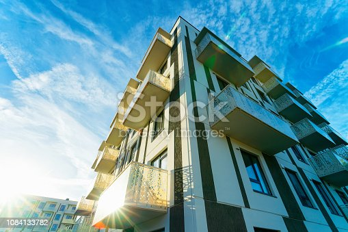 Sun light and Apartment house and home residential building architecture concept. Place for a copy space. Blue sky