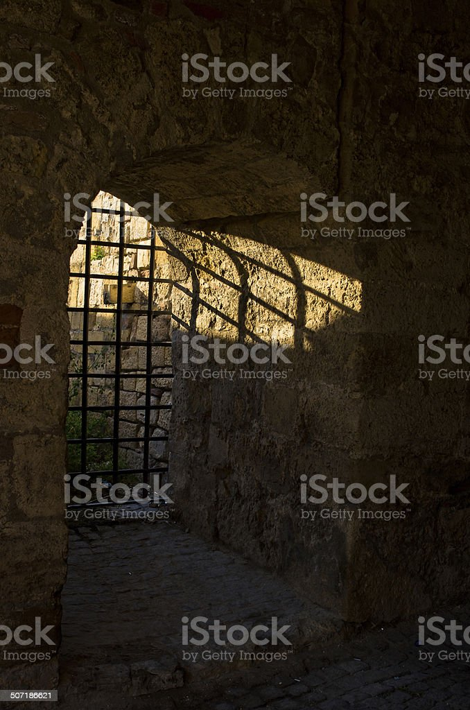 Sun light through the dungeon bars at Kalemegdan fortress, Belgrade Sun light through the dungeon bars at Kalemegdan fortress, Belgrade, Serbia Ancient Stock Photo