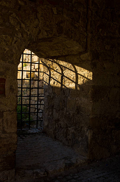 Sun light through the dungeon bars at Kalemegdan fortress, Belgrade Sun light through the dungeon bars at Kalemegdan fortress, Belgrade, Serbia arrestment stock pictures, royalty-free photos & images