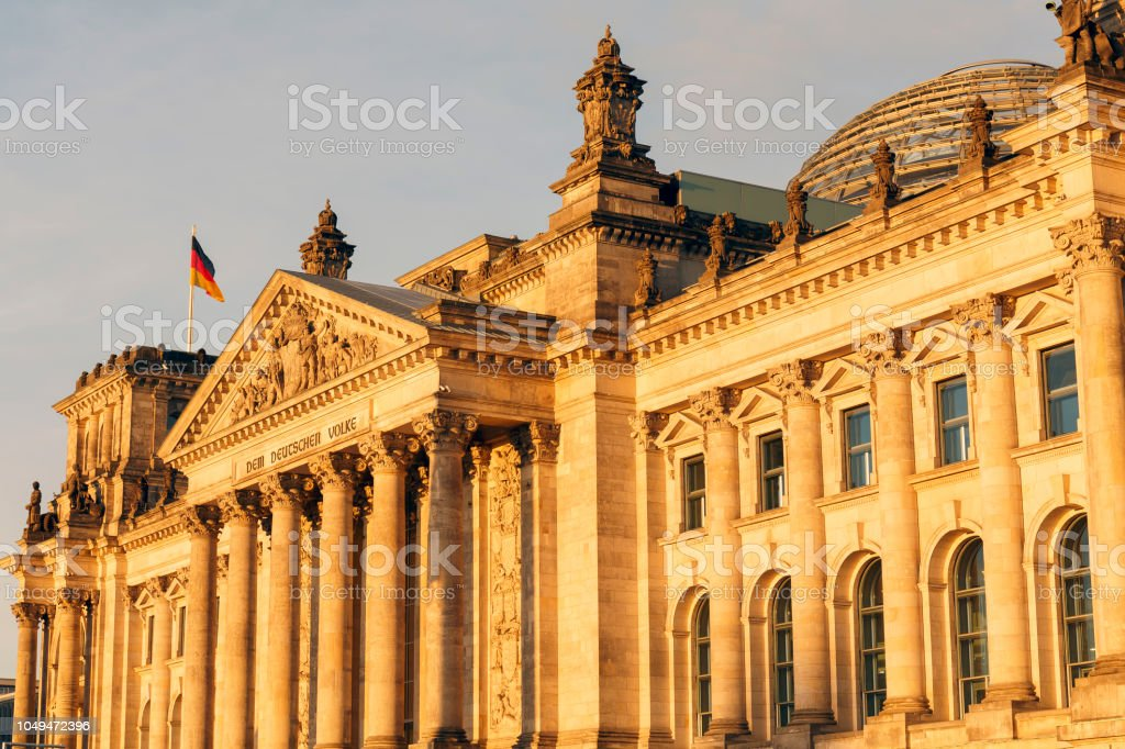 Sun Lit Reichstag Main Facade In Golden Light In Berlin At Sunset