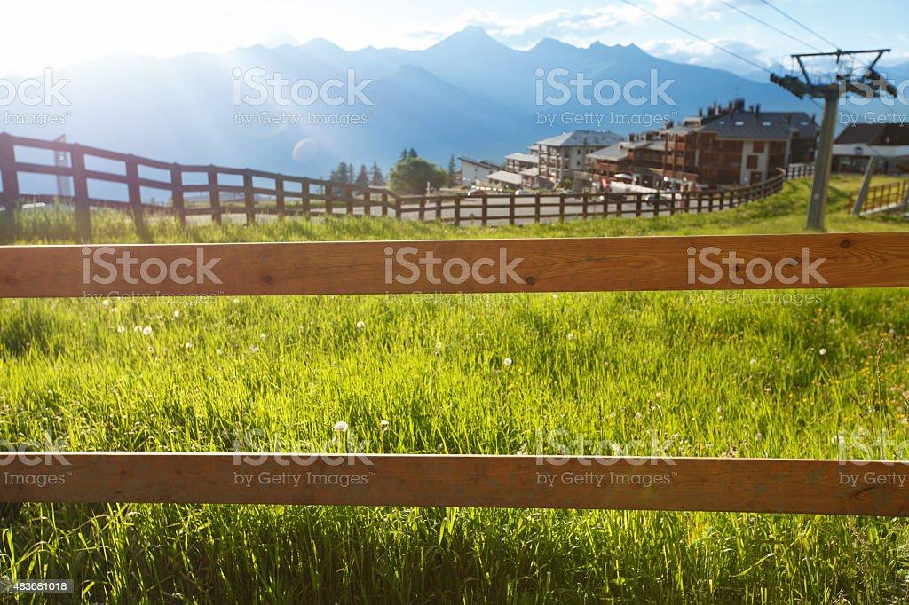 Sun lit wooden fence near Pila cable car station stock photo