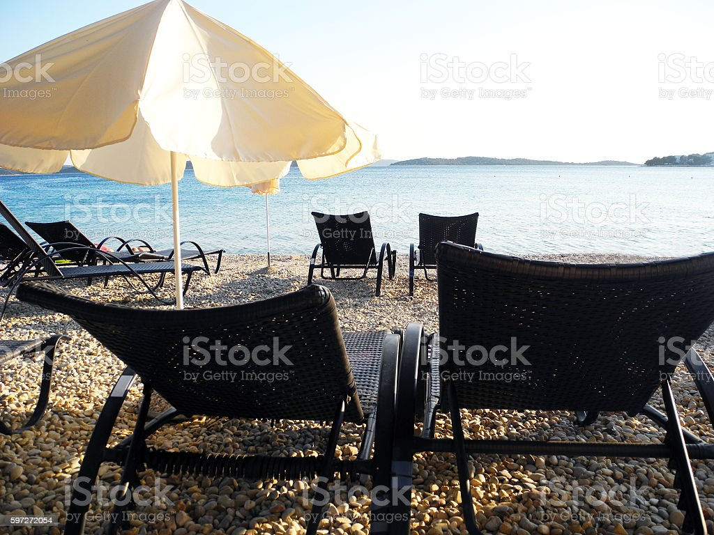 Sun loungers on the beach in Vodice. royalty-free stock photo