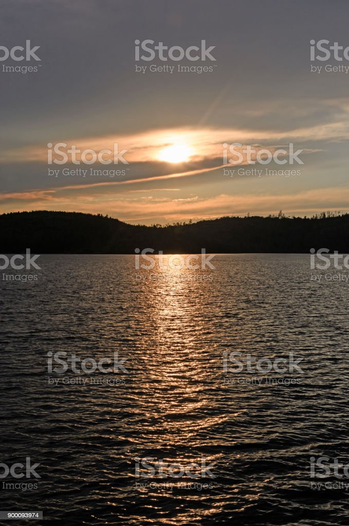 Sun Lurking behind the Clouds at Sunset stock photo