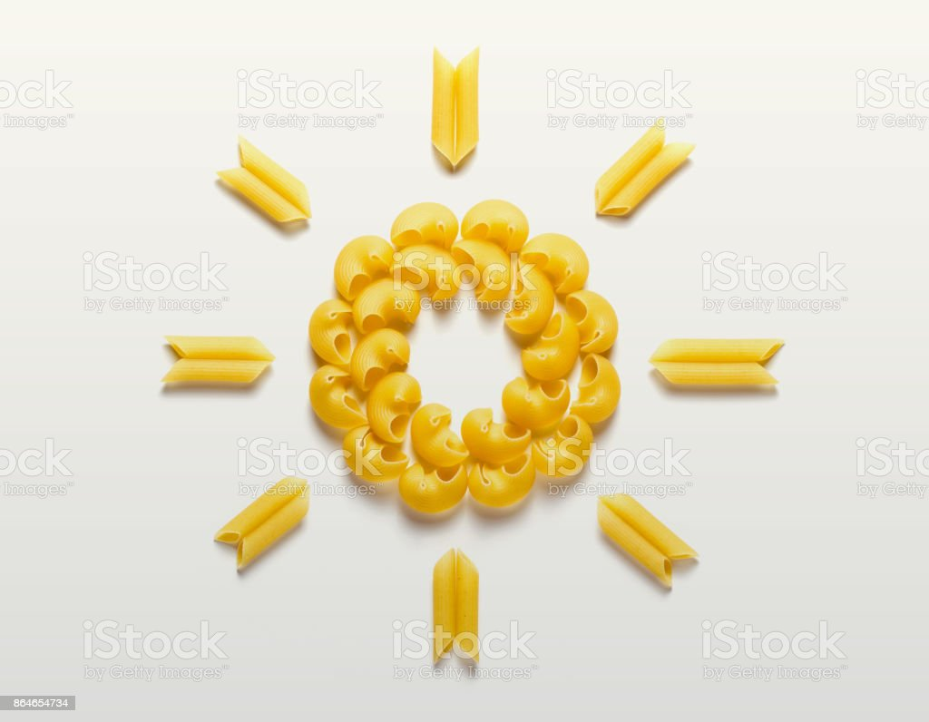 Sun made from pasta on white background stock photo