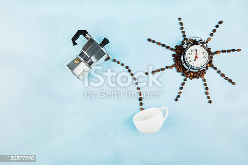 istock Sun made of coffee beans on blue background. Concept begins morning with coffee. Top view, copy space. Food background 1150527220
