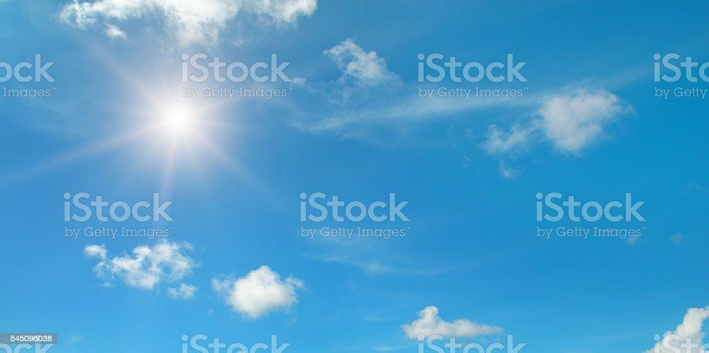 sun on blue sky with clouds圖像檔