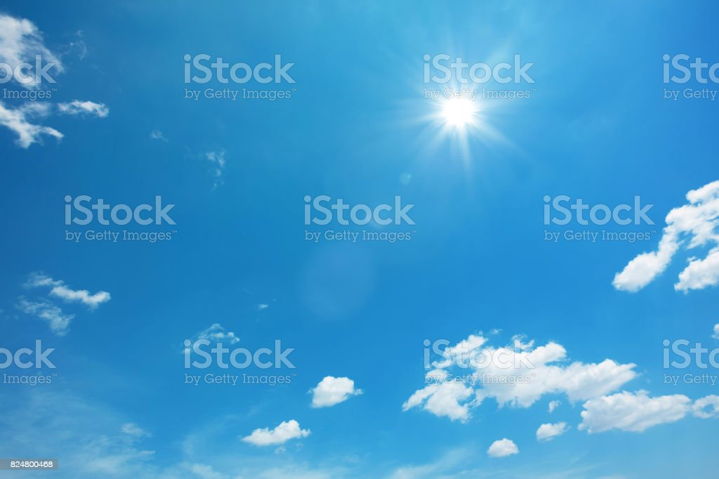 Sun on blue sky with clouds stock photo