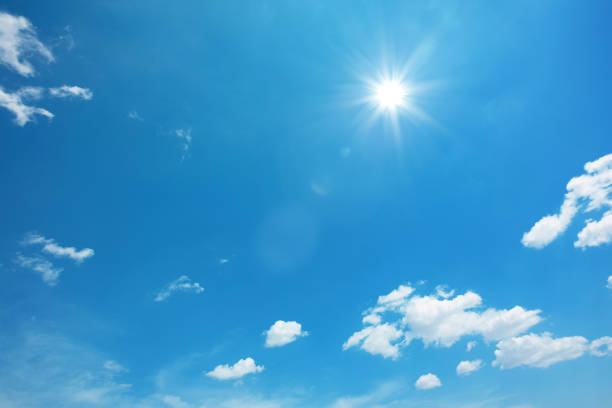 sun on blue sky with clouds - skies stock photos and pictures