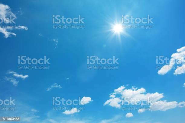 Sun on blue sky with clouds