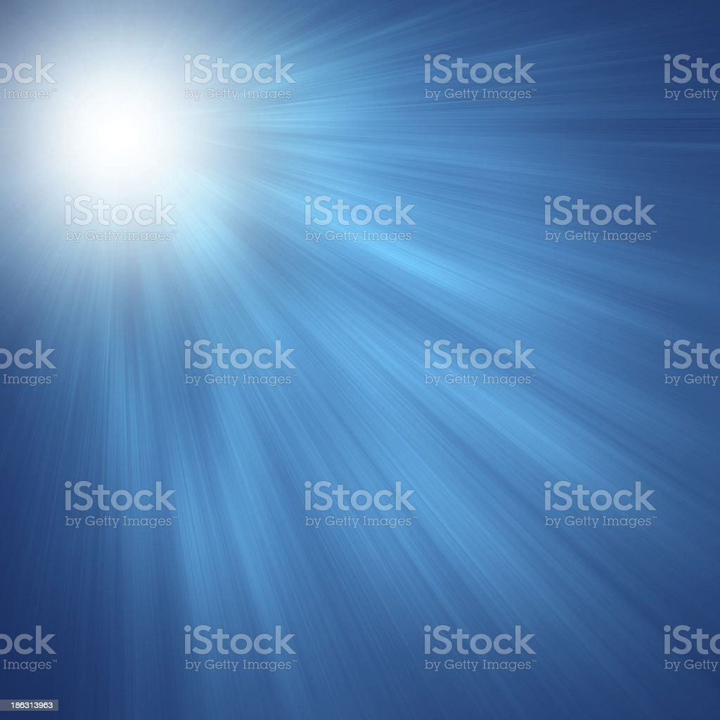 Sun on blue sky with lenses flare stock photo