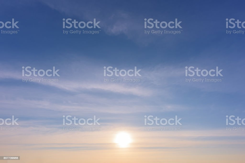 sun on sunset sky stock photo