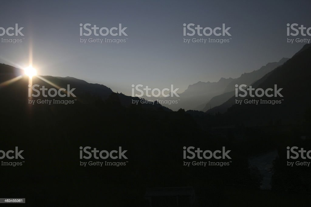 Sun over Engadin in the morning royalty-free stock photo