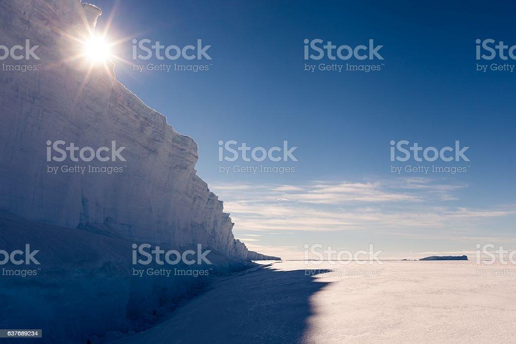 Sun over giant ice wall stock photo