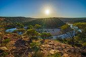 sun over horseshoe bend, kalbarri national park, western australia 3
