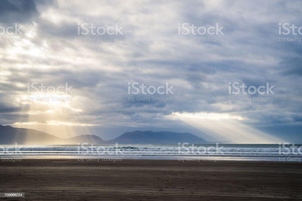 Sun over Kerry beach stock photo