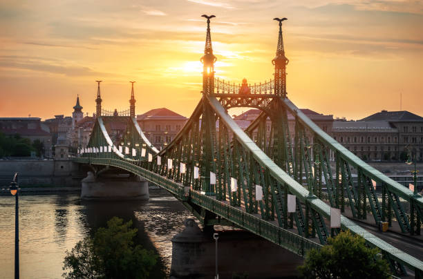 Sun over Liberty Bridge Sun over Budapest Liberty Bridge in the morning, Hungary liberty bridge budapest stock pictures, royalty-free photos & images